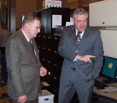 Representative Mark Smith of Marshalltown, on right, gives Curt Hanson, on left, a tour.
