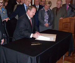 Governor Culver signs early retirement law.