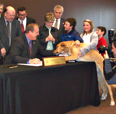 Governor Culver signs puppy mill bill as Buck watches.
