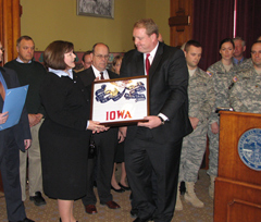 Jill Whitten accepts a framed flag from Governor Culver.