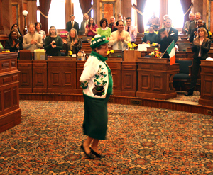Representative Delores Mertz dances the jig.