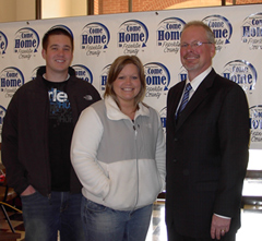 "Joel & Stephanie McWilliams ""Come Home to Franklin County"" participants with Brad Davis, Hampton State Bank president."