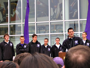 UNI coach Ben Jacobson addresses send off rally as players look on.