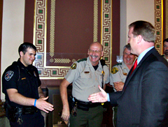 Governor greets law officers prior to signing the gun bill.