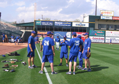 Iowa Cubs team members warm up.
