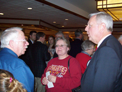 Rod Roberts talks with Iowans for Tax Relief members after forum.