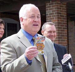 "Iowa Lottery CEO Terry Rich shows off ""Silver ticket"""