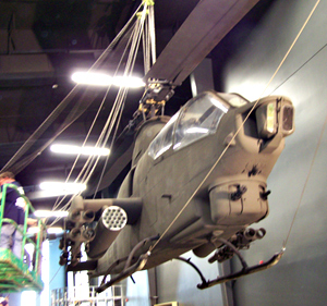 Cobra helicopter being raised in the Iowa Goldstar Military Museum.
