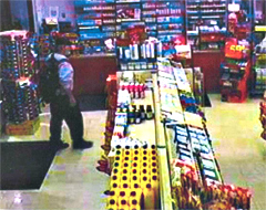 Man in store prior to kidnapping of clerk.