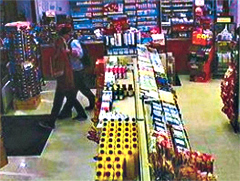 Survelience photo showing clerk Amanda Daniel leaving store with man.