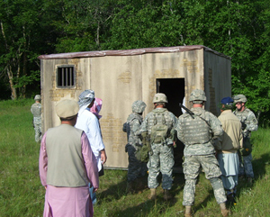 Iowa National Guard soldiers with Afghan actors in training exercise.