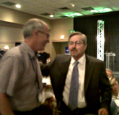 Terry Branstad talks with a suppoter at campaign stop in Ames.