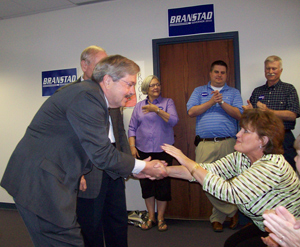 Terry Branstad talks with a supporter during a campaign event.