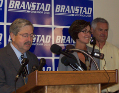 Terry Branstad introduces Kim Reynolds as her husband, Kevin Reynolds listens.