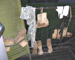 Boots of ING soldiers drying after wet day of training.