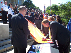 Govenror Culver signs a pledge to not text while driving.