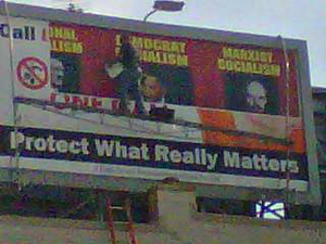 Billboard featuring President Obama being covered up today in Mason City.