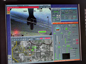 Computer screen showing camera view and location of the UAV.