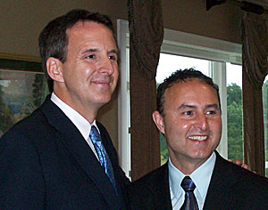 Pawlenty poses with GOP congressional candidate Ben Lange