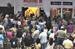 People gather around to see the special butter sculpture at the Iowa State Fair.