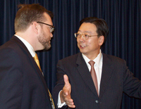 Chinese Counsel General General Yang Guoqaing talks with a reporter.