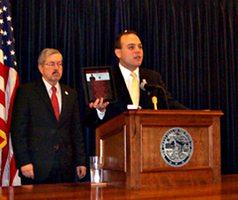 Secretary of State Matt Schultz showcases a new voting app with Governor Branstad (file photo)