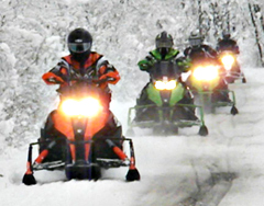 Snowmobiles on the trail. (DNR Photo)