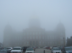 Many parts of Iowa were covered in ice, while the Iowa Statehouse was covered in fog Monday.