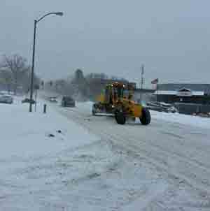 Grader works to clear a street in Des Miones.