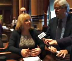 Senators Pam Jochum and Jack Hatch talk after meeting with Governor Branstad.
