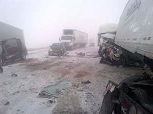 This chain reaction crash on I-35 in northern Iowa on 12/20/12 was blamed on snow/ice covered road.