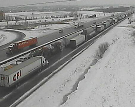 A DOT camera shows traffic backed up on I-80 due to an accident.