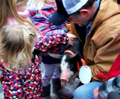 Governor Branstad's granddaughers pet pardoned pig.