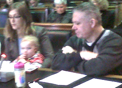 ACLU of Iowa's Rita Bettis holds Dan Copeland's child.