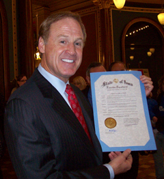 Rusty Wallace displays a proclamation from the governor  honoring him for his work on the Iowa Speedway.