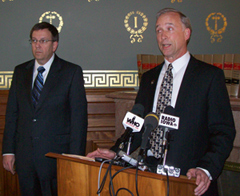 Republican Representatives Craig Paulson and Chuck Soderberg (L-R)  talk about budget targets.