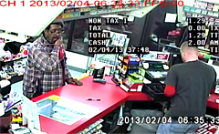 Photo from surveillence video of suspect cashing stolen lottery tickets