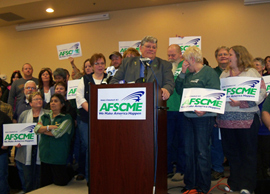 AFSCME members celebrate an aribitrator's ruling on their new contract.