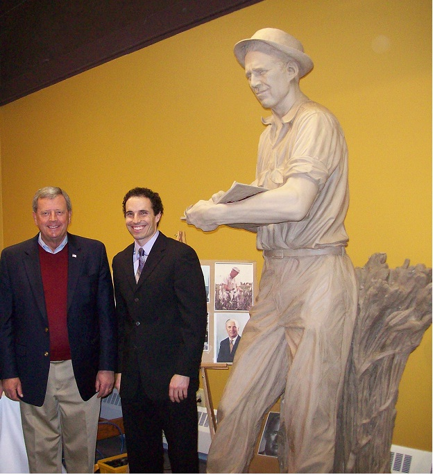 U.S. Rep. Tom Latham (left), sculptor Ben Victor & the Borlaug sculpture