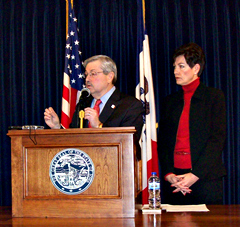 "Governor Branstad talks about the ""Healthy Iowa Plan"" as Lt. Governor Reynolds listens."