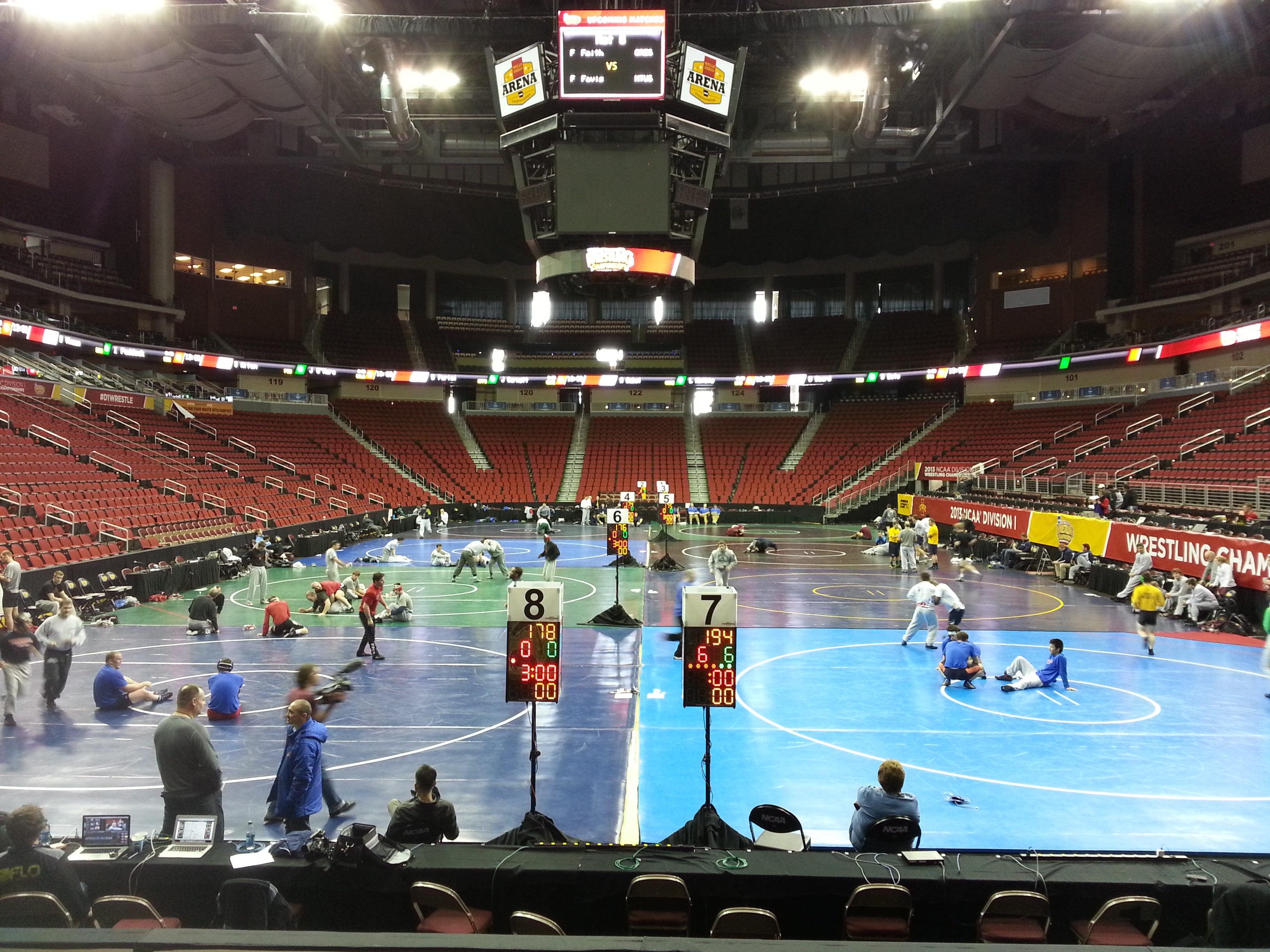 Wrestlers warming up Wednesday inside Wells Fargo Arena