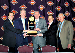 Iowa coach Fran McCaffery (2nd from left) holds the championship trophy with other NIT coaches.