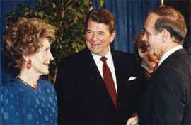 Former Governor Bob Ray (right) with President and Mrs. Reagan.