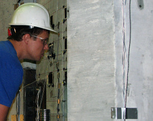 Grant Schmitz inspects concrete used for a wind turbine tower.