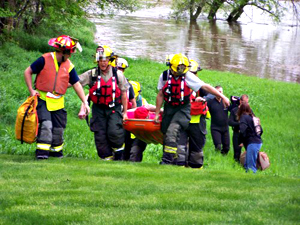 Ray Luecke was carried out of his flooded home by firefighters.