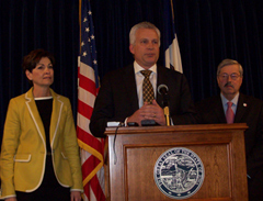MidAmerican's Bill Fehrman, middle, with Governor Branstad & Lt. Governor Reynolds.