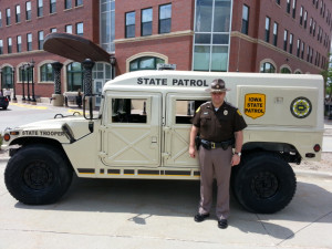Lt. Robert Hansen and a State Patrol Humvee.