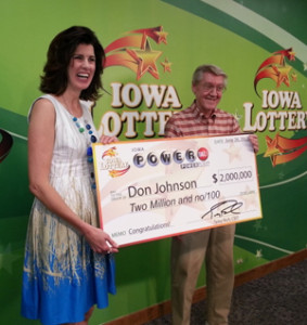 Lottery spokeswoman Mary Neubauer with Powerball winner Don Johnson.