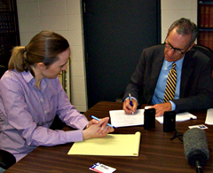 Karger fills out complaint, with Megan Tooker of the Iowa Ethics & Campaign Disclosure Board.