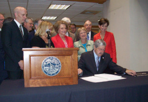 "Governor Branstad signs the ""Iowa Health and Wellness Program"" into law."